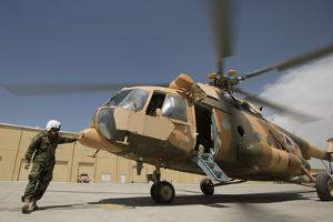 An Afghan Air Force Aerial Gunner Makes Final Checks on a Mi-17 Helicopter