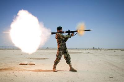 An Afghan National Army Soldier Fires a Rpg-7