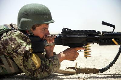 An Afghan National Army Soldier Fires an M240B Machine Gun
