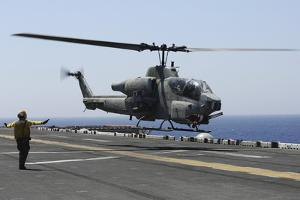 An Ah-1W Super Cobra Takes Off from the Flight Deck of USS Kearsarge