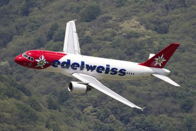An Airbus A320 of Edelweiss Air in Flight over Locarno, Switzerland