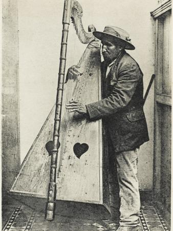https://imgc.allpostersimages.com/img/posters/an-andean-harpist-with-his-harp_u-L-Q108COY0.jpg?p=0