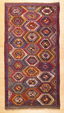 An Antique Gendje Rug, the Field with a Hexagonal Lattice of Panels Contain