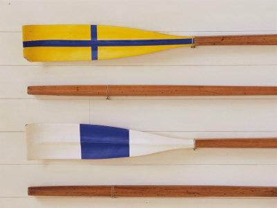 https://imgc.allpostersimages.com/img/posters/an-array-of-boat-oars-mounted-on-a-wall_u-L-Q10S7110.jpg?p=0