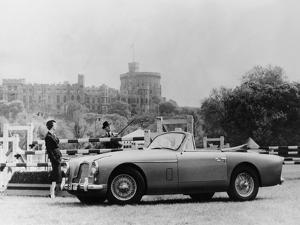 An Aston Martin DB2-4 MKII, with Windsor Castle in the Background, 1956