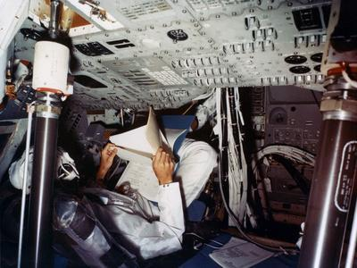 https://imgc.allpostersimages.com/img/posters/an-astronaut-inside-a-nasa-command-module-1970s_u-L-Q10LKYN0.jpg?p=0