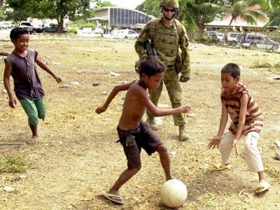 An Australian Soldier Plays with Displaced East Timorese Children