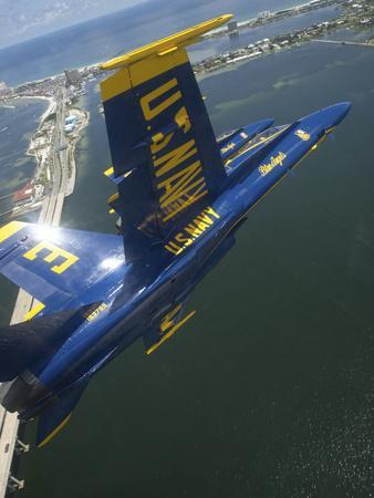https://imgc.allpostersimages.com/img/posters/an-f-a-18-hornet-of-the-blue-angels-over-pensacola-beach-florida_u-L-PJ0B270.jpg?p=0