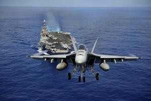 An F-A-18E Super Hornet Flying Above USS John C. Stennis