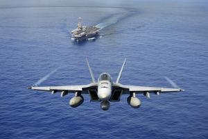 An F-A-18E Super Hornet Flying Above USS John C. Stennis