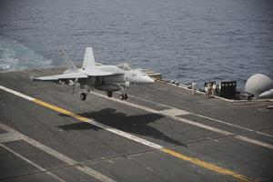 An F-A-18E Super Hornet Lands Aboard the Aircraft Carrier USS Nimitz