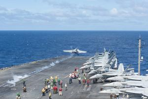 An F-A-18E Super Hornet Launches from the Flight Deck of USS George Washington
