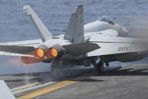 An F-A-18E Super Hornet Launches from USS Nimitz