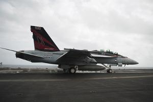 An F-A-18F Super Hornet Launches from USS Nimitz