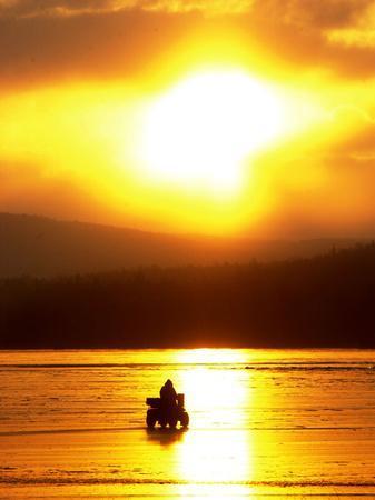 https://imgc.allpostersimages.com/img/posters/an-ice-fisherman-motors-across-the-frozen-surface-of-lake-champlain-near-the-milton-south-hero-vt_u-L-Q10OPRA0.jpg?p=0