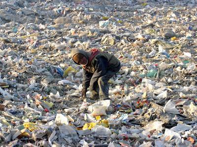 https://imgc.allpostersimages.com/img/posters/an-impoverished-mongolian-man-sorts-through-garbage-at-an-ulan-bator-dump_u-L-Q10OVAF0.jpg?artPerspective=n