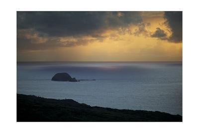 https://imgc.allpostersimages.com/img/posters/an-island-beneath-stormy-sunrise_u-L-Q1CAM5Q0.jpg?artPerspective=n