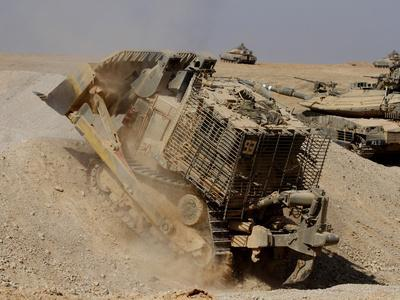 https://imgc.allpostersimages.com/img/posters/an-israel-defense-force-caterpillar-d-9-clearing-the-way_u-L-PJ37I70.jpg?artPerspective=n