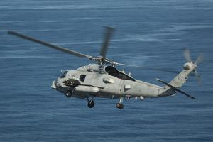 An Mh-60R Sea Hawk Maneuvers over the South China Sea