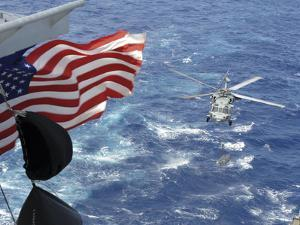 An Mh-60S Sea Hawk Carries Supplies During a Replenishment at Sea