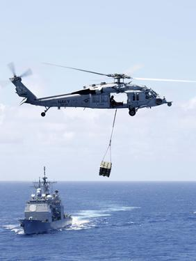 An Mh-60S Sea Hawk Helicopter Flying in Front of USS Gettysburg