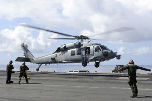 An Mh-60S Sea Hawk Lands on the Flight Deck of USS John C. Stennis
