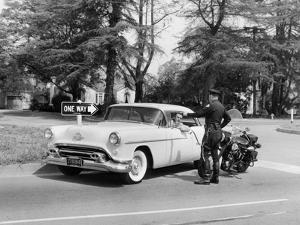 An Oldsmobile at the Corner of an American Street, 1954