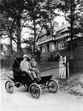 An Oldsmobile Curved Dash, 1902