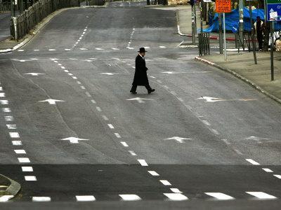 https://imgc.allpostersimages.com/img/posters/an-orthodox-israeli-jew-walks-across-an-empty-road-during-the-sabbath_u-L-Q10OT540.jpg?artPerspective=n