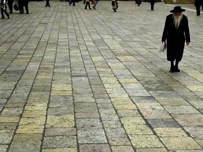 https://imgc.allpostersimages.com/img/posters/an-orthodox-israeli-jew-walks-across-the-plaza-next-to-the-western-wall_u-L-Q10OT4J0.jpg?p=0