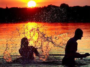 An Unidentified Couple Splashes in Lake Wandlitz Near Berlin on a Warm Evening