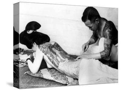 An Unidentified Japanese Tattoo Artist Works on a Woman's Backside