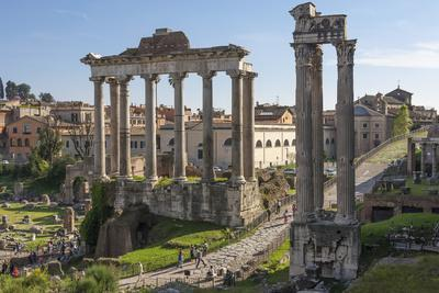 https://imgc.allpostersimages.com/img/posters/ancient-roman-road-traverses-the-columns-and-ruins-in-the-forum-of-ancient-rome-rome-lazio-italy_u-L-PWFBN80.jpg?p=0