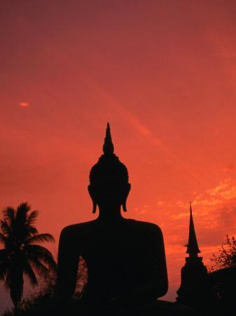 Buddha Against a Sunset at Wat Mahathat, Sukhothai, Thailand
