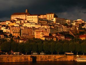Dark Clouds at Sunset Hang Over the Velha Universidade (Old University) of Coimbra, Portugal by Anders Blomqvist