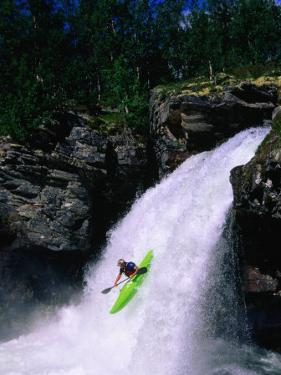 Kayaker Going Down Waterfall of Store Ula River, Rondane National Park, Norway by Anders Blomqvist