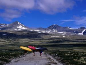 Kayakers Walking to Ula River, Rondane National Park, Oppland, Norway by Anders Blomqvist