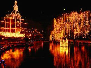 Lake in Tivoli Gardens Illuminated for Christmas Market, Copenhagen, Denmark by Anders Blomqvist