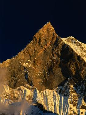 Machhapuchhare's West Face Glowing in the Sunset,Gandaki, Nepal by Anders Blomqvist
