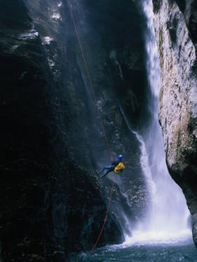 Man Canyoning in Waterfall, Nepal by Anders Blomqvist