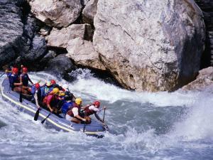 Raft Going into Big Dipper Rapid at Sun Kosi River, Bagmati, Nepal by Anders Blomqvist