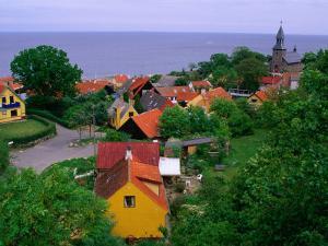 Rooftops Nestled Amongst Trees, Gudhjem, Bornholm, Denmark by Anders Blomqvist