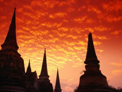 Sun Sets Over the Chedis (Buddhist Stupas) of Wat Phra Si Sanphet, Ayuthaya, Thailand by Anders Blomqvist