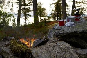 Campfire, shore, Lelång, Dalsland, Sweden by Andrea Lang