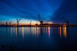 Harbour cranes at dusk, Gothenburg, province of Västra Götalands län, Sweden by Andrea Lang