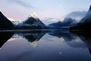 New Zealand, Nuova Zelanda, Fiordland, Milford Sound and Moon During a Cold and Misty Sunrise. by Andrea Pozzi