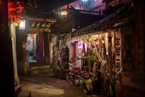 Alley at Night with Tibetan Style Hostel and Motorcycle in Lijiang Old Town, Lijiang, Yunnan by Andreas Brandl