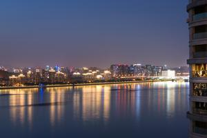 Beautifully illuminated high rises on Qiantang River in Hangzhou, Zhejiang province, China, Asia by Andreas Brandl