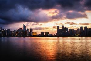 Dramatic clouds over Qianjiang River with skyline of Hangzhou's new business district, Hangzhou, Zh by Andreas Brandl