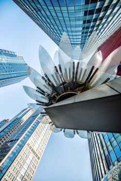 Glass and Metal Lotus Installation in Front of HsBC Bank with Surrounding New Skyscrapers by Andreas Brandl